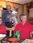 Val, Daddy, and Bambi look on as Carl looks for more presents.