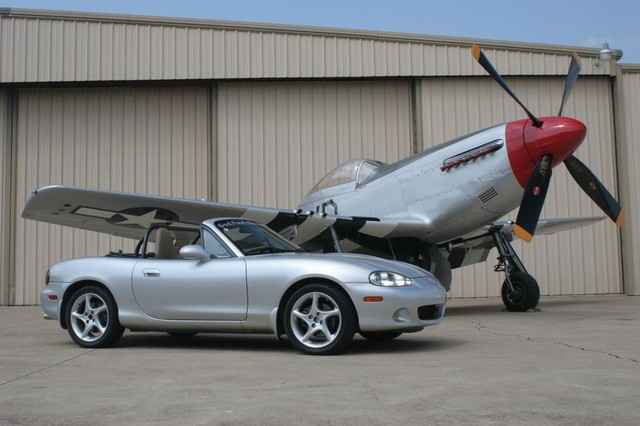 Special permission was obtained to shoot the Miatas next to this P51 Mustang!